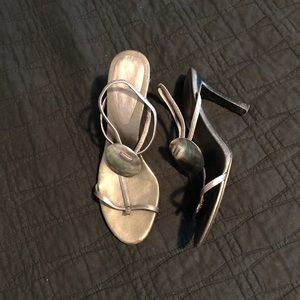 Nine West pewter and abalone shell shoes.